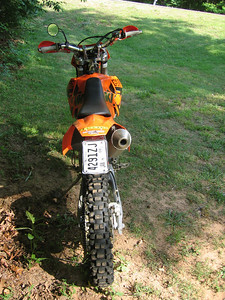 """Acerbis LED tailight & crappy fold-away mirror round out the """"just less than ya need to connect trails"""" road legal package. Not as skinny as my '04 Husky TC450, but a much more docile machine and easier for a 43 year old to ride."""