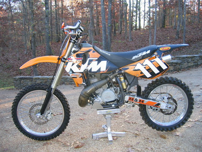 "KTM 550 M/CX. Modified with a ported cylinder, 38mm PWK Airstriker carb, Dynoport pipe, 19"" Excel rear wheel, 48mm WP forks from a 525 SX, Emig Racing billet triple clamps and steering damper, MSR handguards, ProTaper fatbars, wave rotors.   FAST!"
