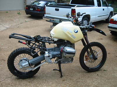 """This has been a long, ongoing project. This machine used to be a '96 R1100GS, but now has an ADVMoto (out of biz) frame, Emig clamps and damper, Marzocchi Shiver forks, BiTubo shock, custom KTM 21"""" front wheel and 4 piston caliper brake, Woody's 18"""" rear wheel, R850 rear drive, and a bunch of other custom made parts.  This will be my long distance adventure bike."""