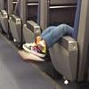 Little girl's feet, train half empty to Warrensburg.