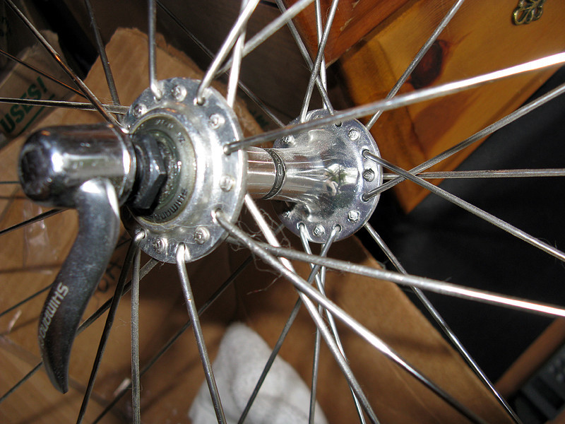 """""""Crow's Foot"""" or hybrid lacing on a Shimano 32-hole small flange front hub."""