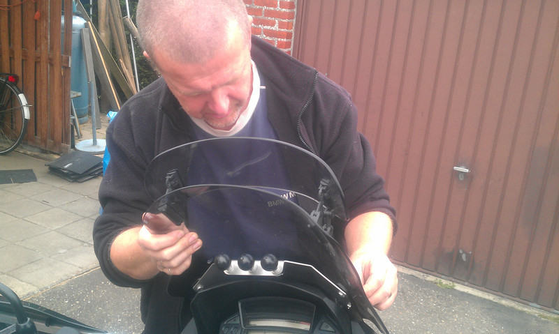 Michel, the MAN AKA miGSel, installing my newly bought satnav mount himself. Excellent job.
