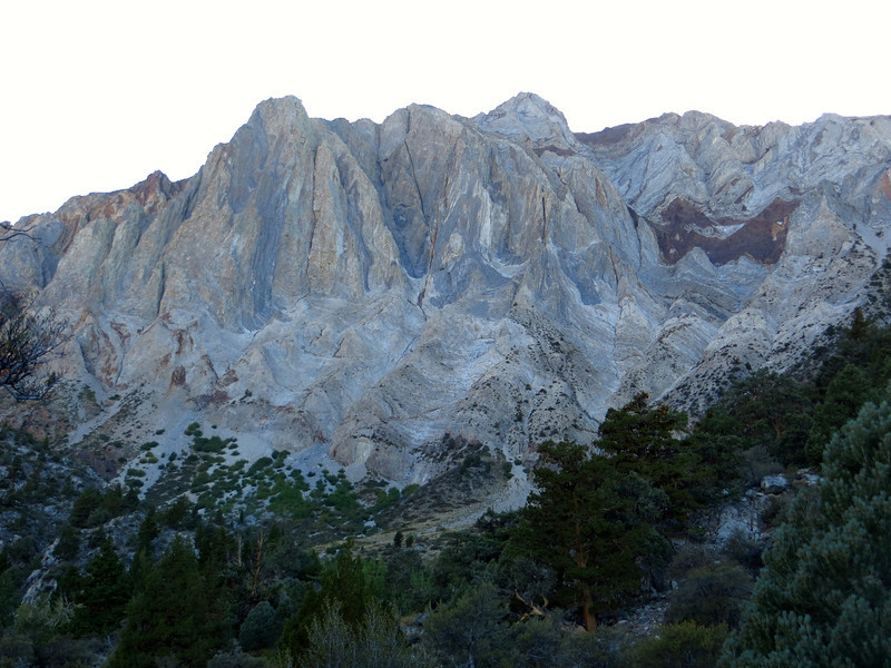 Sevehah Cliff, composed of folded metamorphic rock, provides a colorful backdrop to Convict Lake