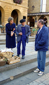 French farmers selling some cepes (mushrooms) at the weekly farmer's market