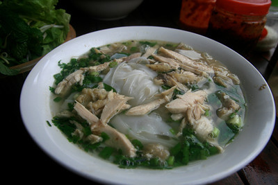 "Delicious ""pho"" - noodle soup with chicken, green onions and mint leaves."