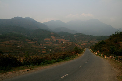 This is kind of the general gist of northwest Vietnam, hills, cleared brownish fields, decent roads without too much traffic.