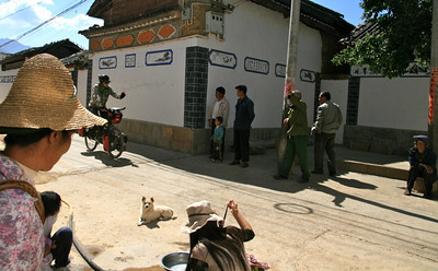 After months and months of being enthusiastically cheered and greeted as we biked through villages I was starting to wonder if they thought we were the circus arriving in town. Adam prefers to pretend he's a prince getting a royal welcome. At the least the dog wasn't fooled.