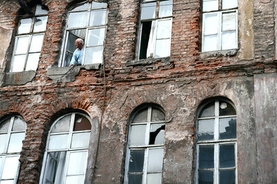 A man looks our his window in Beyoglu District, Istanbul.