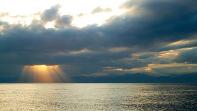 Sun setting on Sicily, south of the Strait of Messina.