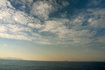 Volcanoes on the horizon. These are the Eolian Islands (where Stromboli is located) north of Sicily.
