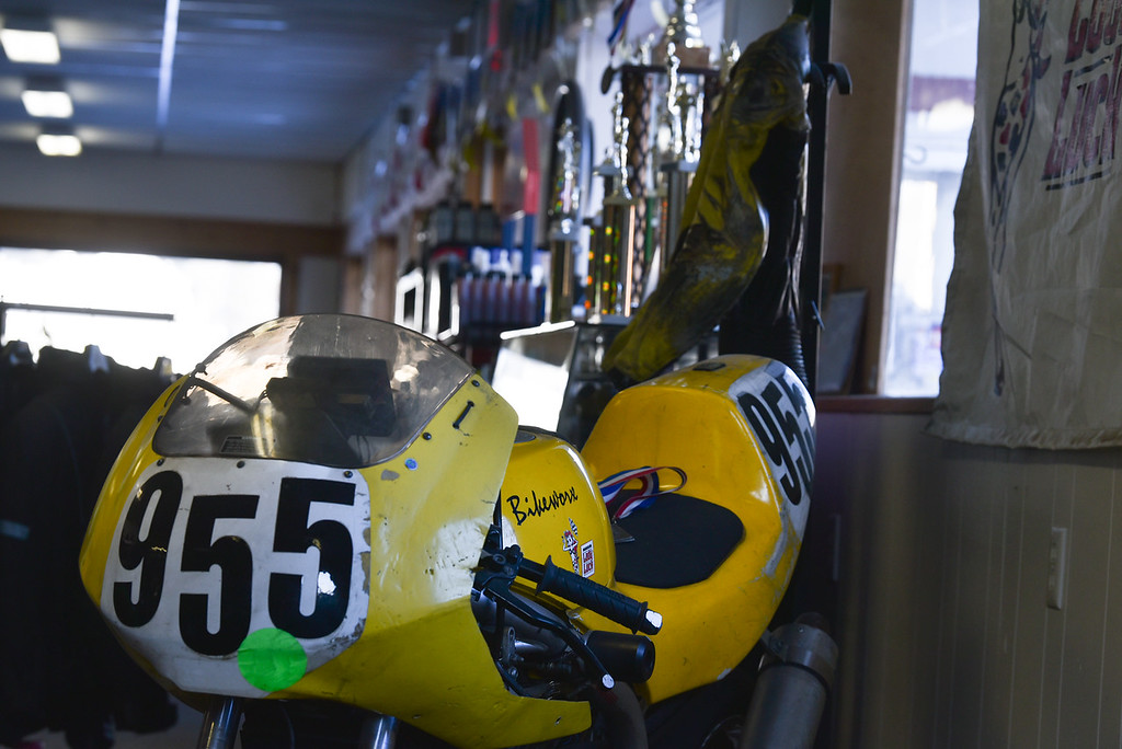 . (03/19/18 AYER MA) A race bike belonging to Galen Miller is on display alongside a number trophies he has earned over the years which are display inside his Ayer based shop called Bikeworx.  SENTINEL & ENTERPRISE JEFF PORTER