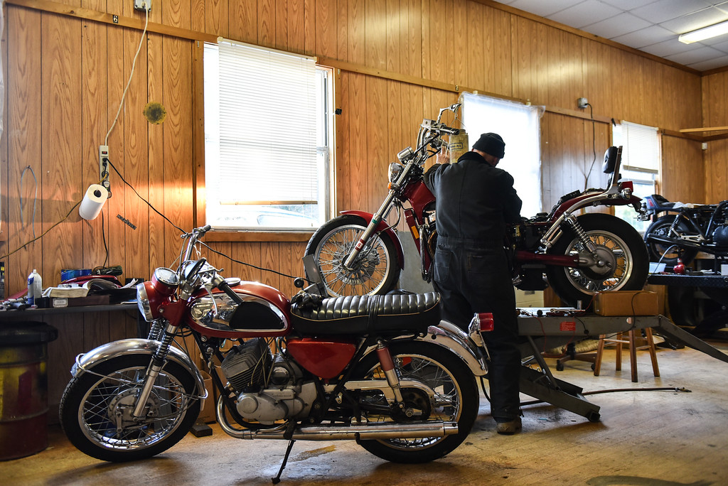 . (03/19/18 AYER MA) Bikeworx owner Galen Miller wrenches away on a bike inside his Ayer based shop on Monday afternoon. SENTINEL & ENTERPRISE JEFF PORTER