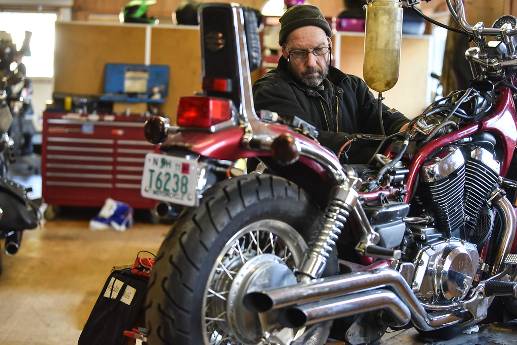 . (03/19/18 AYER MA) Galen Miller wrenches away on a bike inside his Ayer based shop called Bikeworx on Monday.  SENTINEL & ENTERPRISE JEFF PORTER