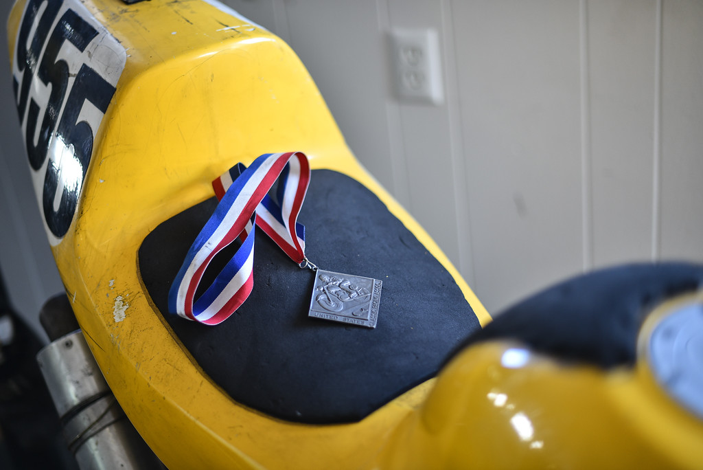 . (03/19/18 AYER MA) A medal rest\'s on the seat of a race bike which belongs to Galen Miller who owns Bikeworx in Ayer.  SENTINEL & ENTERPRISE JEFF PORTER