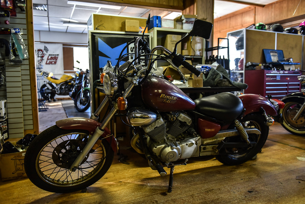. (03/19/18 AYER MA) An old Yamaha set\'s at the entrance to the shop where Bikeworx owner Galen Miller repairs customer bikes and works on various bike related projects at Bikeworx in Ayer on Monday.  SENTINEL & ENTERPRISE JEFF PORTER
