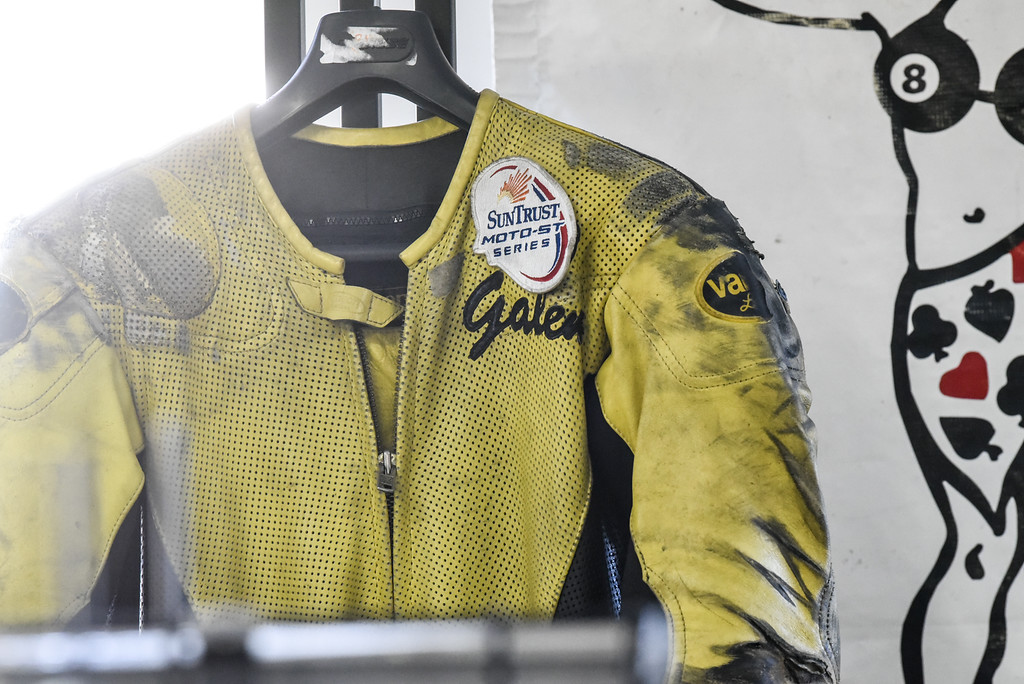 . (03/19/18 AYER MA) A worn race suit belonging to Bikeworx owner Galen Miller sit\'s on display inside his Ayer basked shop on Monday.  SENTINEL & ENTERPRISE JEFF PORTER
