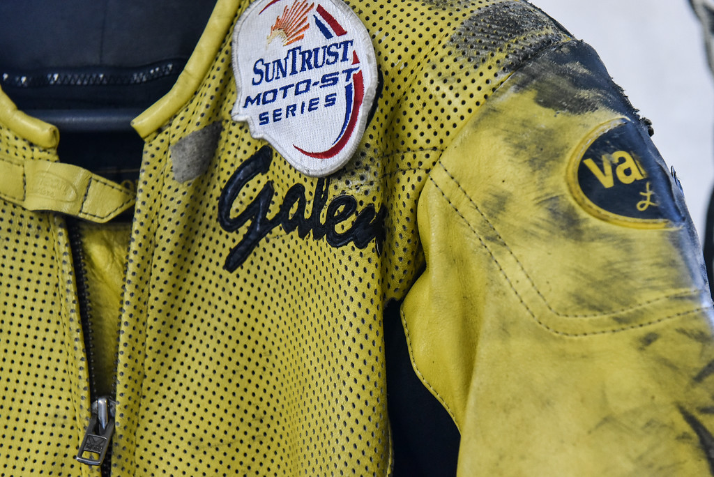 . (03/19/18 AYER MA) The scuffed sleeve of a race suit belonging to Bikeworx owner Galen Miller sit\'s on display inside his Ayer basked shop on Monday.  SENTINEL & ENTERPRISE JEFF PORTER