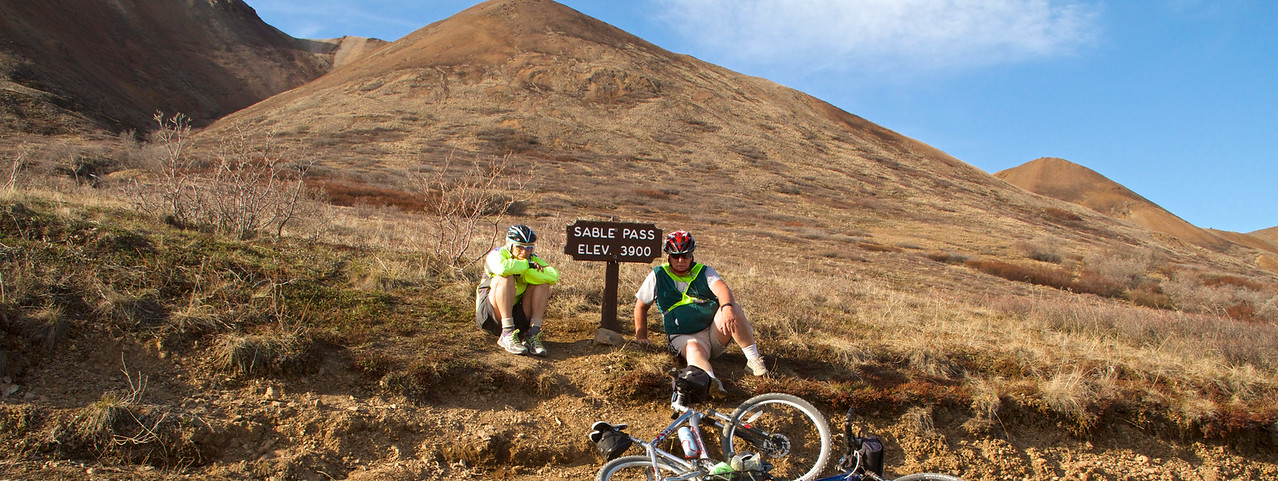 Two tired cyclists on Sable Pass.