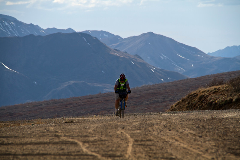 Bill reaching the top of Sable Pass on our way back to Teklanika, the last climb before a nice 8 mille coast....oh yeah, we had to peddle downhill  because of the wind.