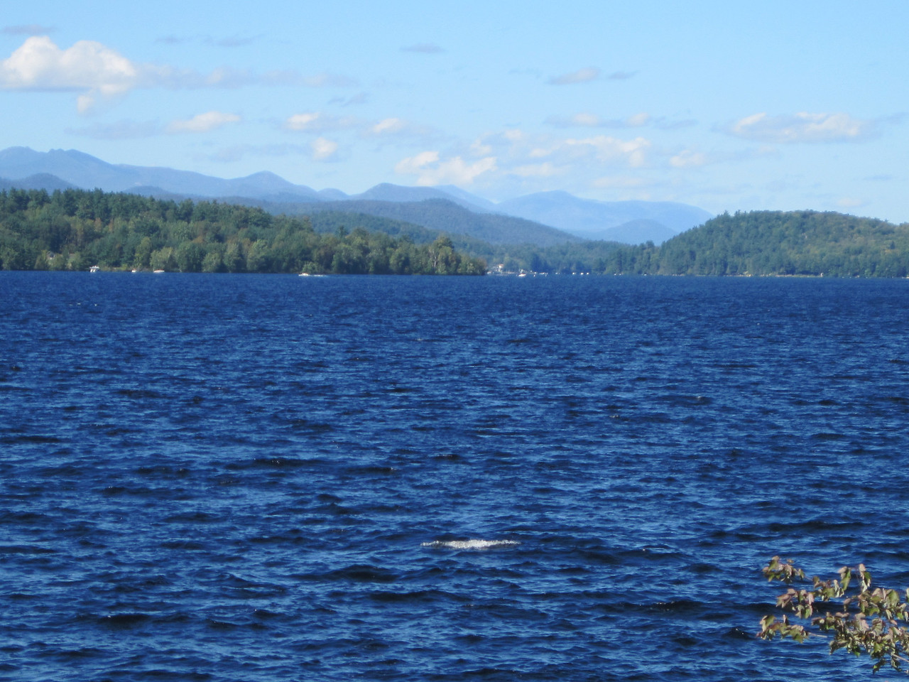While Julie was trying to take a picture of the entire Dix range, she inadvertently caught a picture of the man-eating Schroon Lake Sea Monster. We did not even know how close we were to being fish food. Luckily I can ride pretty fast to escape danger, or at least out ride Julie.