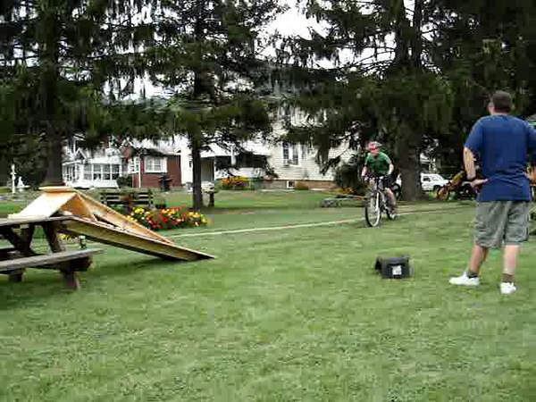 Matt over table landing on back wheel.
