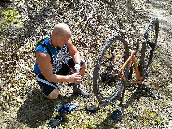 Ken gets his first flat, on the Allegrippis Trails.