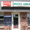 """Early afternoon, and we were getting hungry.  Heard about a place off the trail - but it was closed, on vacation.  Probably a good thing - who would want to eat at a place called Muck's?  """"All you can eat - the Muck special.""""  Muck? - yuck."""