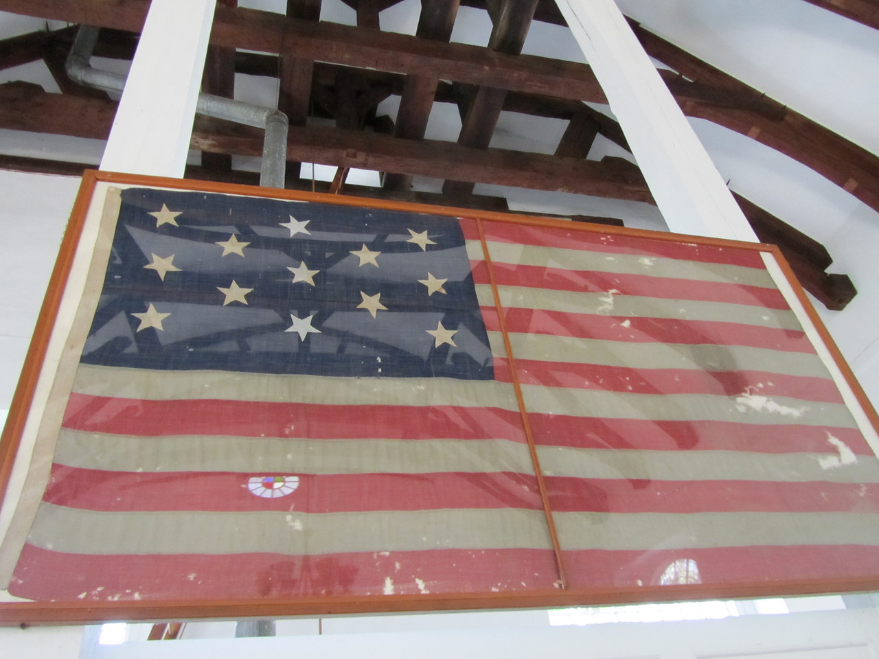 Two interesting points. <br /> 1. This bulding was made without nails. All post and beam with wooden dowels and still standing strong.<br /> 2. This flag was not present when the church was built (since we were still a part of England) but was made when we were just 13 colonies. I have never seen a flag with 13 stars and the stars not be in a circle. Betsy Ross must have made a few prototypes and G. Washington did not like this one.