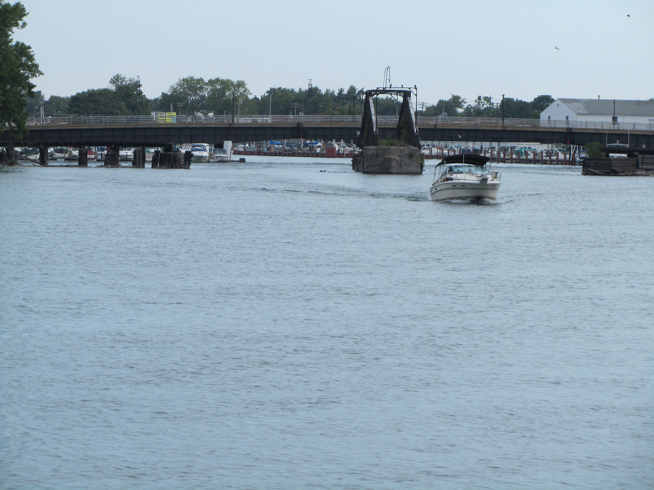 An old rotating bridge opened up to allow a boat to pass.