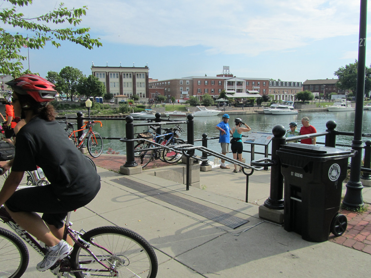 Beautiful downtown with bikes, cars and boats living harmoniously.