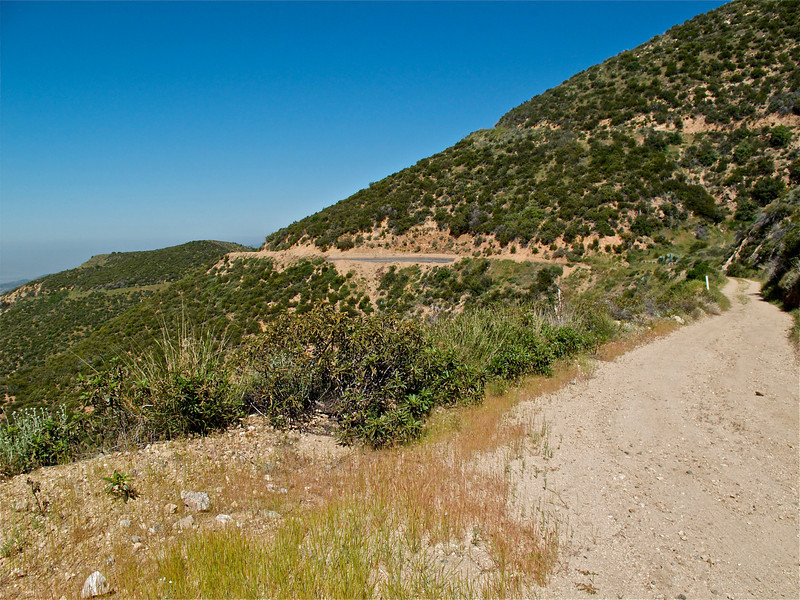 Switchbacks and more work softened by glorious vistas.