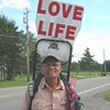 """Steve Fugate is walking the perimeter of the USA.  He's been at it 7000 miles and 18 months now.  He has a message for all, and you're looking at it.    Google """"steve fugate"""" to learn more.  I took these photos on rte. 44 south of Chardon August 11, 2004."""