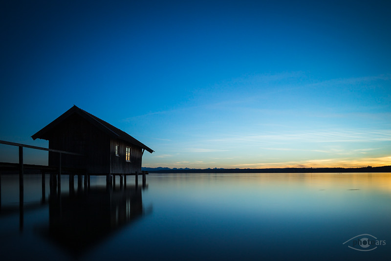 Sonnenuntergang an den Bootshäusern am Ammersee, Stegen, Oberbayern, Bayern, Deutschland