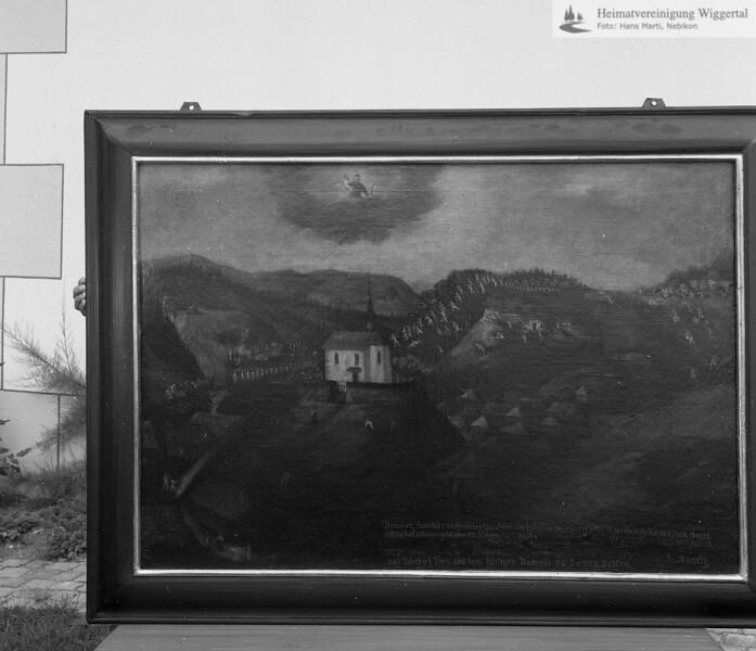 #170363 | Antoniuskapelle; Votovbild an der westseitigen Kapellenwand:; Der hl.Antonius bewahrt Altbüron vor der Plünderung durch die siegreichen Berner; fja; s.200251