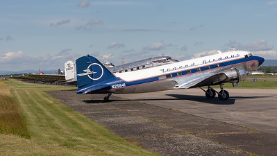 12 DC-3 in a row during engine run-up at Wiesbaden