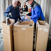 From left, Bob Daly of Billerica and Peter Coppinger sort out bottles and cans at the Billerica Public Library, wich will help fund programs that are not in the library's budget. Bob Alger has been organizing this for roughly 25 years. SUN/Caley McGuane