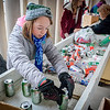 Ava Gottmann-Hanrahan, 10, of Billerica volunteers to help sort out cans and bottles which will benefit the Billerica Public Library. SUN/Caley McGuane