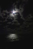 The moonlight glittering off the ocean was a calming sight.