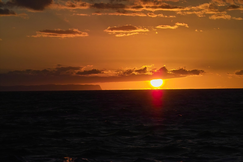 Closer view of sunset with Niihau Island in the background.