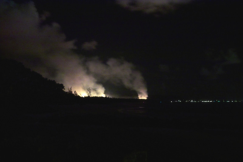 Burning sugar cane is a regular event on Kaua'i, but we had not seen the burning at night.  This is looking north again towards Kapaa.