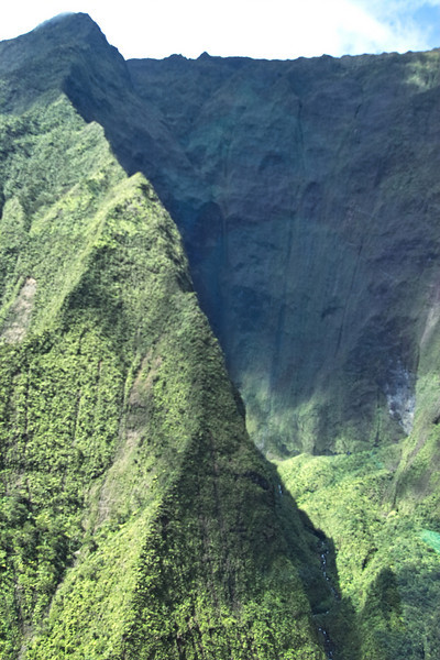 A great view of the remains of the crater of Mt. Waialeale.  This is the wettest spot on the face of the Earth, collecting over 400 inches of rain annually.  It was very unusual to be able to see and fly directly into the crater.