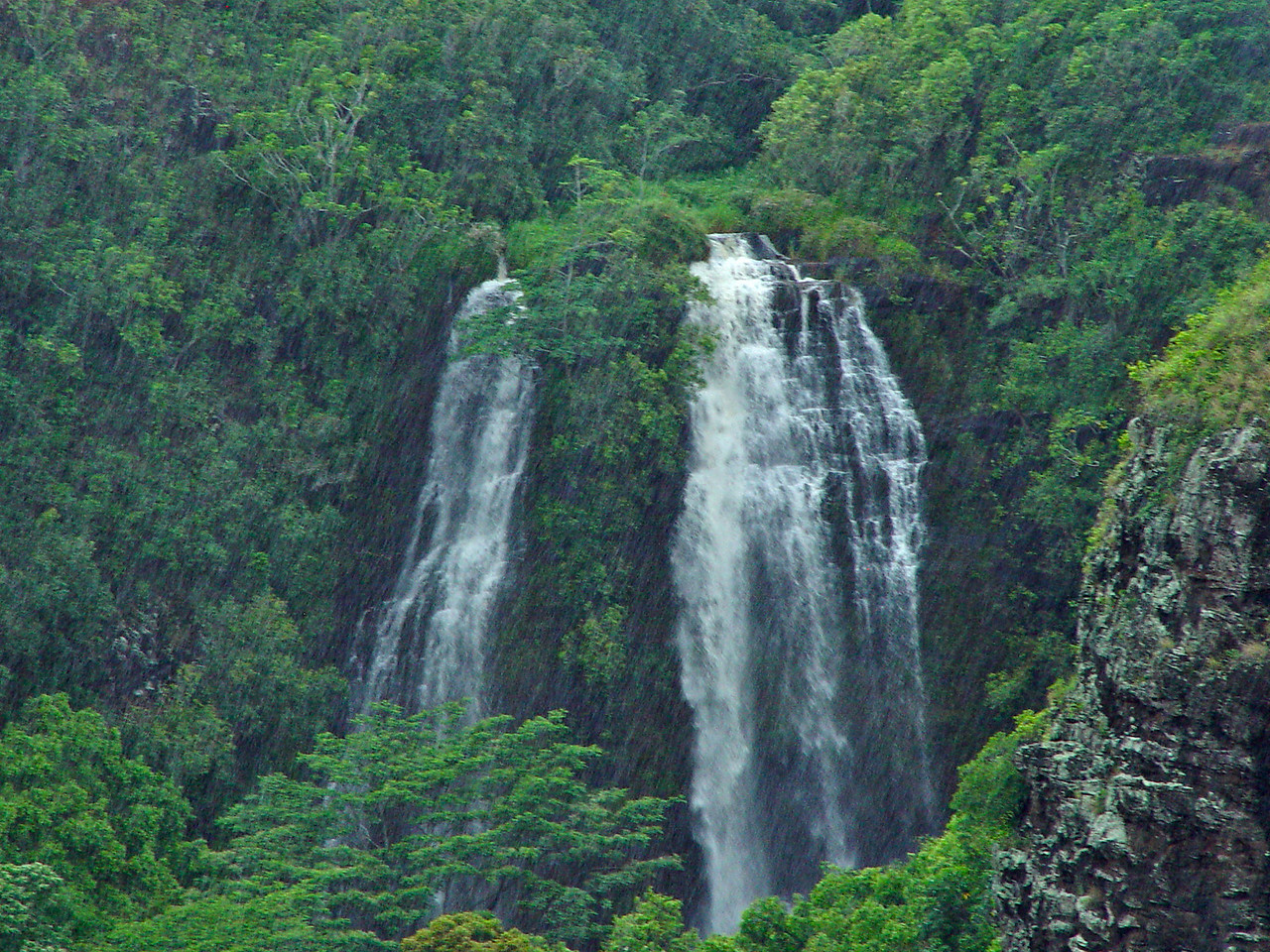 Further up Highway 580 from Wailua we found Opaeka'a Falls.  These falls were also engorged with water and provided a spectacular view.