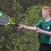 Billerica Memorial High School number-two singles tennis player junior Grant Milliken returns the ball during action against Chelmsford High School. SUN/JOHN LOVE
