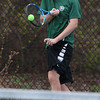 Billerica Memorial High School number-one singles tennis player sophomore Jacob Burke returns the ball during action against Chelmsford High School. SUN/JOHN LOVE