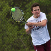 Chelmsford High School No. two singles tennis player sophomore Sam Segal returns the ball during action against Billerica Memorial High School. SUN/JOHN LOVE