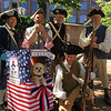 (l to r) Members of the Billerica Colonial Minute Men were asked to pose with a very patriotic pooch after the July 4 parade in Boston. l to r in back: Bill Brimer of Tewksbury, Tom Boisvert of Natick, Joseph Judson and Dan Burns of Billerica. Richard MacKay of Billerica is in front. Photo by Mary Leach