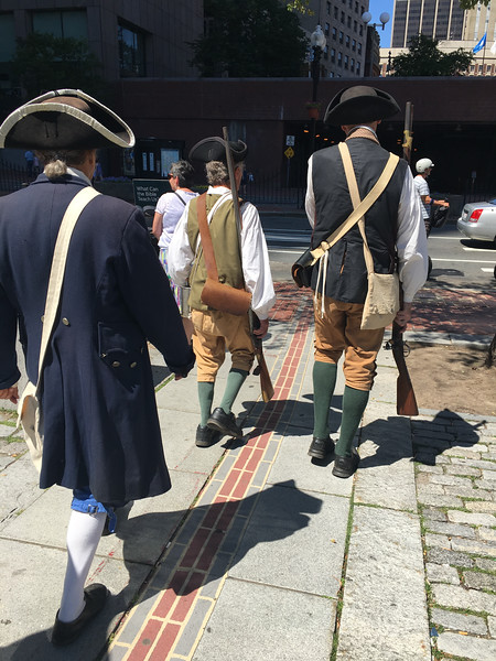 The Billerica Colonial Minute Men walk along the Freedom Trail in Boston on July 4. Photo by Mary Leach
