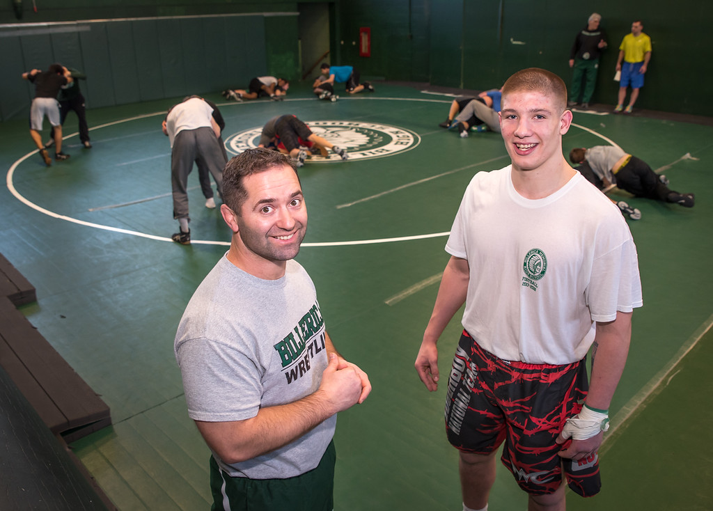 . Billerica wrestler, Senior, Ryan Higgin, 18, with his Coach, Bob Belanger, Monday afternoon during practice. Belanger has been with BHS for 13 seasons, earning coaching awards.  Photo:  Scot Langdon / SUN
