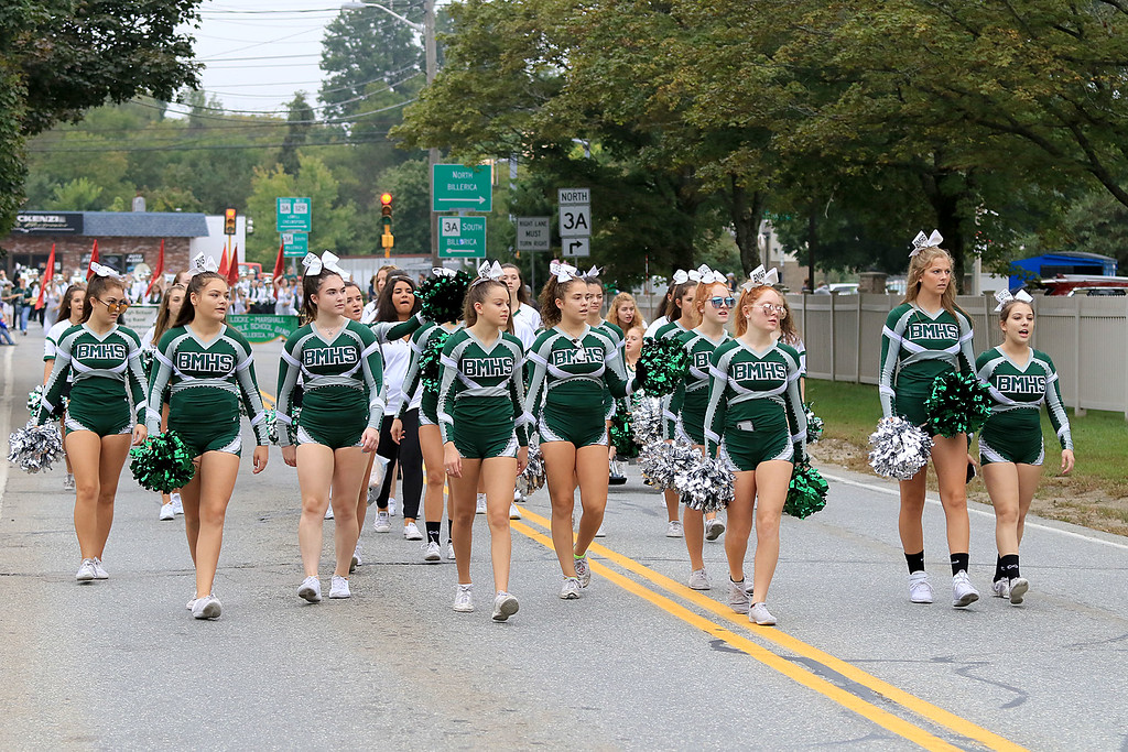 . Walking in the Billerica Yankee Doodle Homecoming Parade on Saturday, September 15, 2018 is the Billerica Memorial High School cheerleaders. SUN/JOHN LOVE