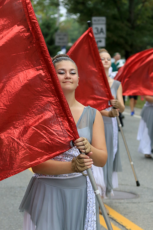 . Walking in the Billerica Yankee Doodle Homecoming Parade on Saturday, September 15, 2018 is Melissa Atkins with the Billerica Memorial High School Color Guard. SUN/JOHN LOVE